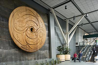 A piece called Flight Spindle Whorl by artist Susan Point welcomes passengers to the Customs Hall in the International Terminal at Vancouver International Airport. Photo: Larry Goldstein.