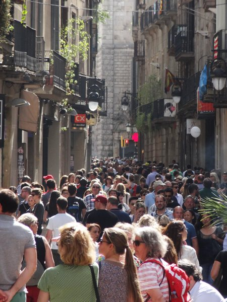 The streets were alive with the throngs of tourists. Photo copyright Laura Byrne Paquet.